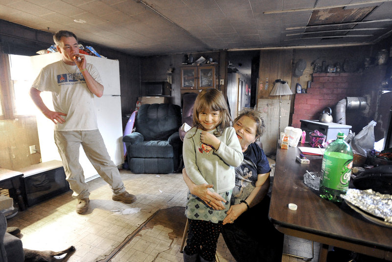Robert Chapman and his sister Wendy Turner, and her 6-year-old granddaughter, Jadelynn Lee, seen here in their living room, were among the occupants during a home invasion in Steep Falls early Friday.