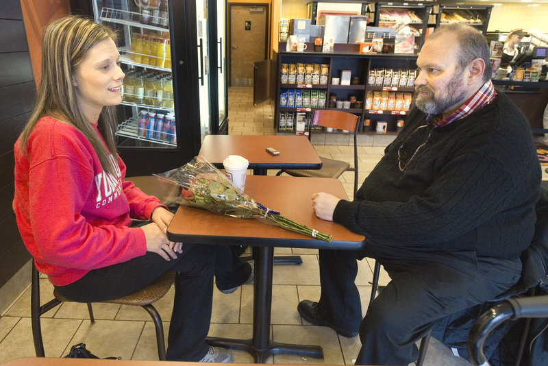 Ashley Caston meets Jim Scanlon at Dunkin' Donuts in Kennebunk on Friday. She came across an accident in Arundel two weeks ago and stayed with Scanlon, the driver, until help arrived.