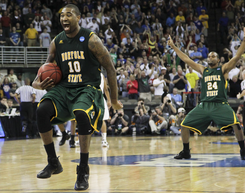 Kyle O'Quinn of Norfolk State celebrates Friday after his team pulled off a huge upset, knocking off second-seeded Missouri 86-84 at Omaha, Neb. The 15th-seeded Spartans will take on seventh-seeded Florida in the next round Sunday.