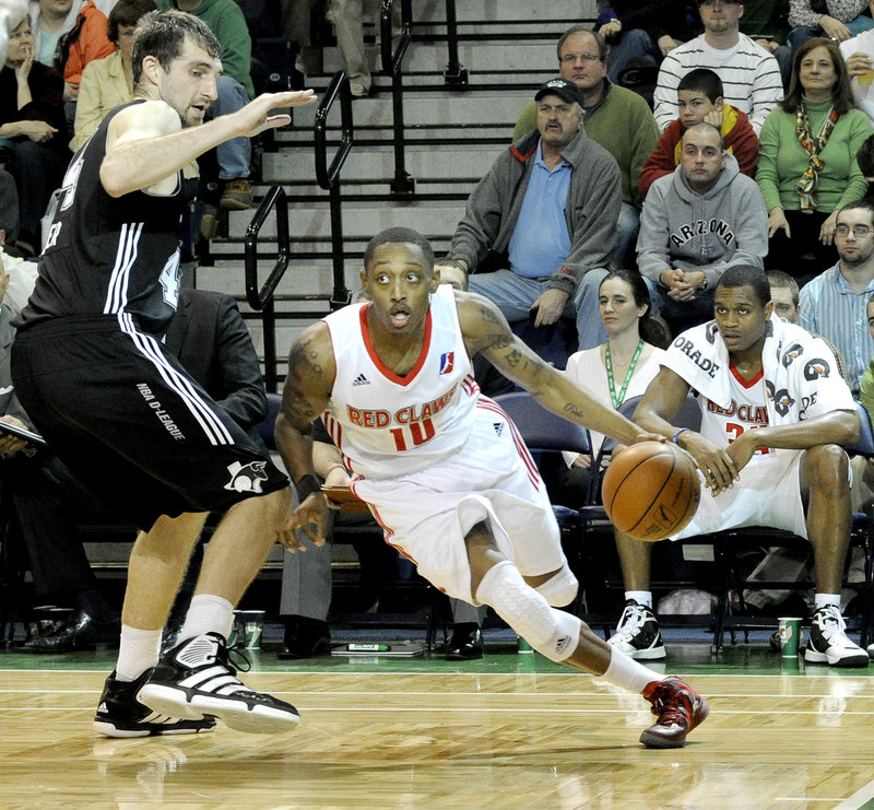 Kenny Hayes of the Maine Red Claws finds room along the baseline to drive against Luke Zeller of the Austin Toros at the Portland Expo. The Red Claws suffered a 119-112 loss.