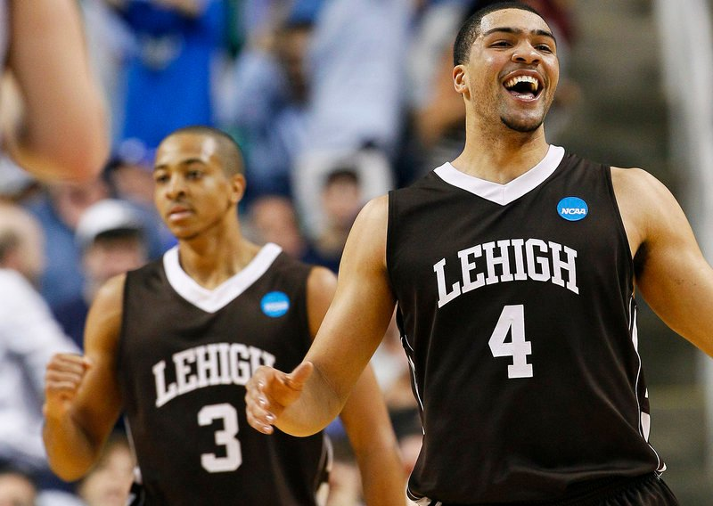 John Adams, right, and C.J. McCollum start the celebrations for Lehigh after the Mountain Hawks delivered a startling 75-70 victory against Duke at Greensboro, N.C.
