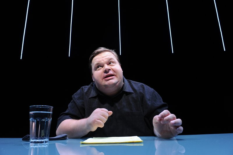 """Mike Daisey is shown in a scene from """"The Agony and The Ecstasy of Steve Jobs."""" The Public Theater in New York says it stands by the work and that Daisey is """"not a journalist."""""""