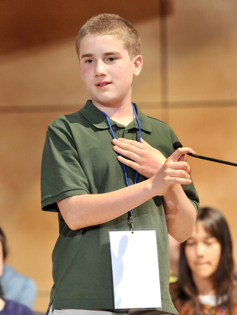 Nat Jordan, 12, the Cumberland County contestant, spells his final word to win the Maine State Spelling Bee on Saturday.
