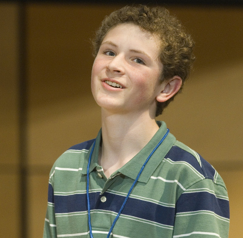 Third-place finisher Ben Philbrook, representing Aroostook County, smiles in frustration after misspelling a word late in the competition.
