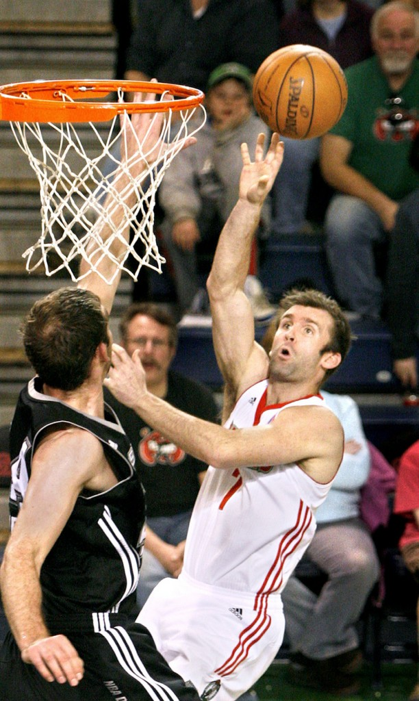 Mike Gerrity of the Red Claws shoots over Luke Zeller of the Austin Toros in the first half of their game Sunday at the Portland Expo.