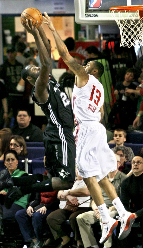 Xavier Silas of the Red Claws tries to block the shot of Julian Wright of the Toros during Sunday's game at the Portland Expo. The Toros won easily.