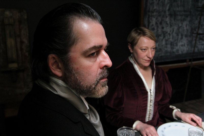 "James Hoban (Pastor Manders) and Karen Ball (Helen Alving) in ""Ghosts."""