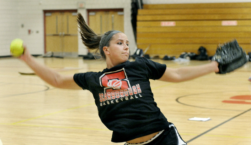 Erin Giles warms up at Scarborough High on Monday, the first day of spring practice. Giles is recovering from a knee injury and is excited to show her coach what she has been working on during the off-season.