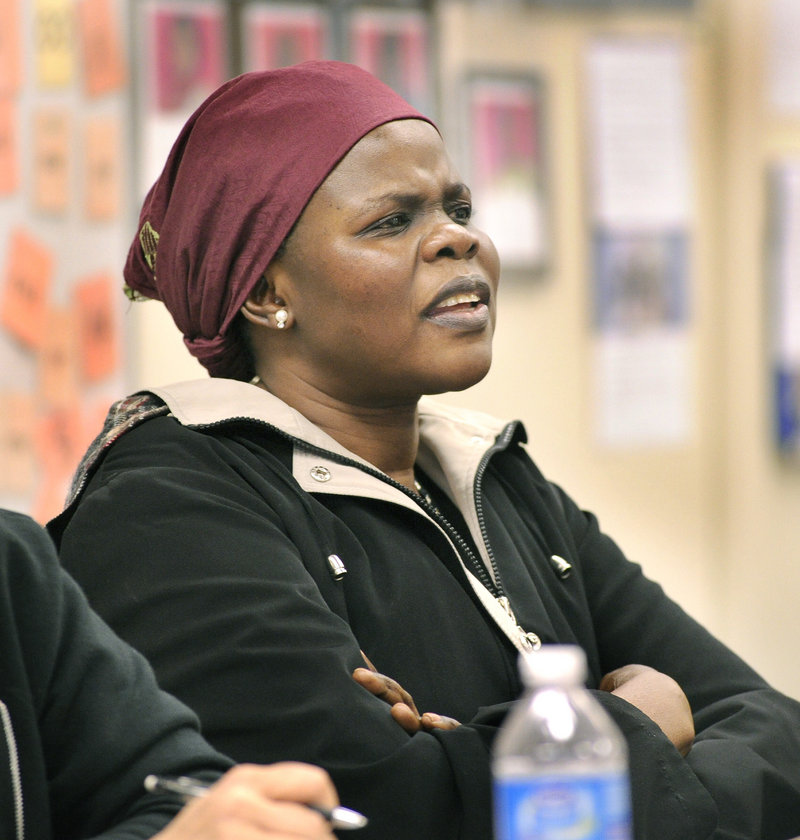 Christina Marring from Sudan listens to teacher Sarah Staples in an English class at the West School.