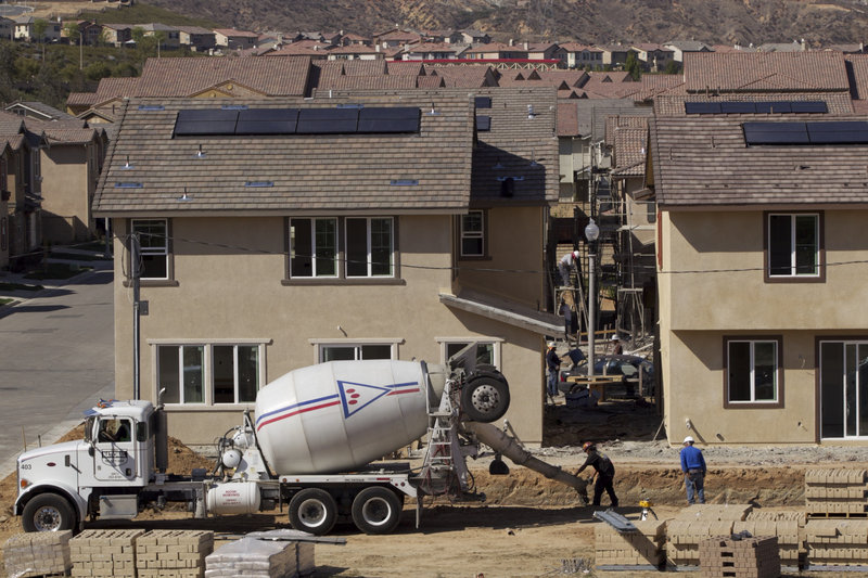 The construction company Lennar works on new single-family homes last week at the Aria at West Creek development in Santa Clarita, Calif. Compared with last year, 2012 is expected to be better for home construction.