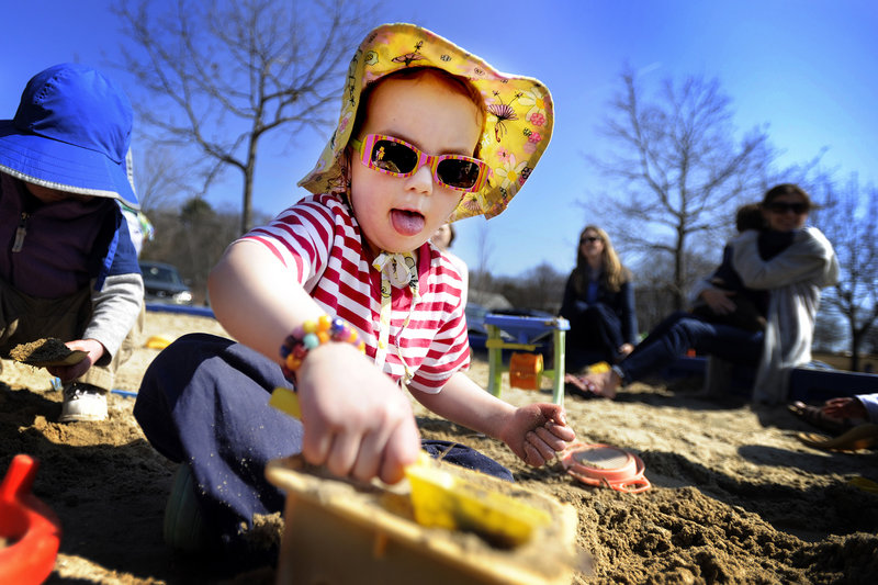 Emma Shannon, 3, enjoys the near-70-degree weather Tuesday by taking to the sandbox at the North Road playground in Yarmouth. The Portland area has already seen two record highs this week, and there may be two more today and Thursday.