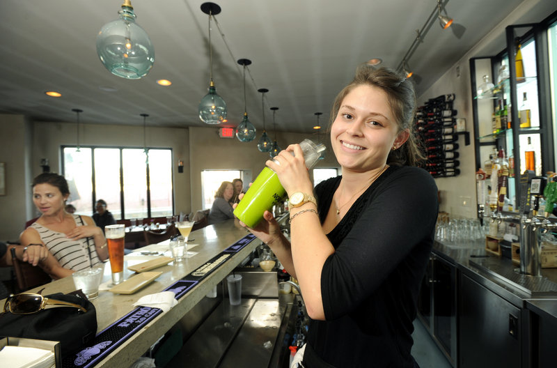 Bartender Talia Rendall mixes a house margarita at El Rayo's Cantina.