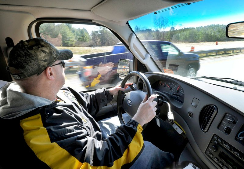 Maine State Police Trooper Steven Stubbs spots a driver using his cellphone and speeding as Stubbs and fellow Trooper Michael Cook patrol the Maine Turnpike in an unmarked van looking for drivers who are texting Thursday morning. The driver was issued a ticket.