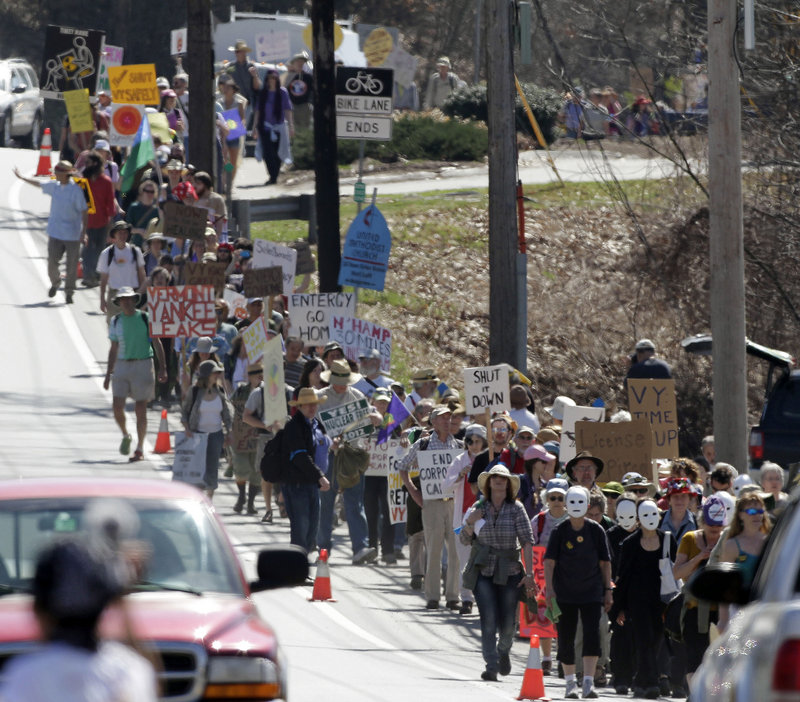Hundreds of anti-nuclear activists march to the local corporate offices of Vermont Yankee owner Entergy Corp. on Thursday in Brattleboro, Vt. Dozens were later arrested.