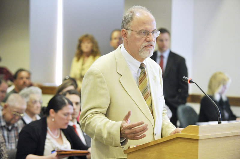 Dale Denno, DHHS director of family independence services, presents the LePage administration's proposed reductions to the General Assistance budget to the Appropriations Committee at a public hearing Thursday in Augusta.