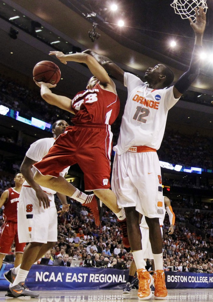 Rob Wilson of Wisconsin attempts to get off a shot while defended by Baye Keita of Syracuse during the second half of Syracuse's 64-63 victory Thursday night.