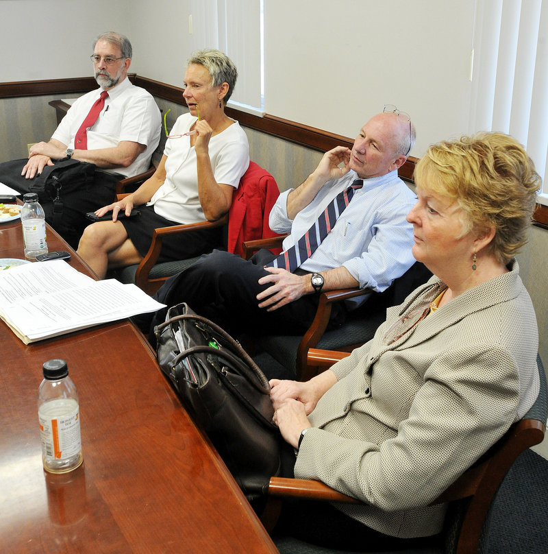 Portland Mayor Michael Brennan attends a lunch meeting with other mayors on Thursday. From left are Biddeford's Alan Casavant, Waterville's Karen Heck, Brennan and Westbrook's Colleen Hilton.