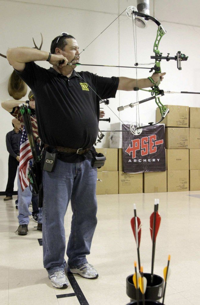 Archer Dennis Robbins on the shooting range at Hi-Tech Archery in Fullerton, Calif.