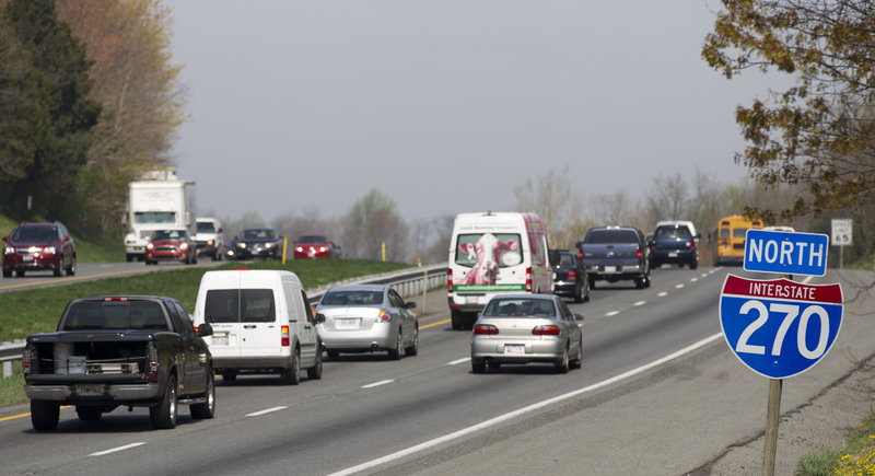 Vehicles head north on Interstate 270 near Hyattstown, Md., Friday. Maryland State Police say an armored truck lost some cash near here and motorists stopped to grab what they could.