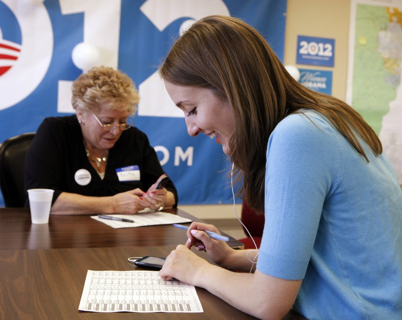 Volunteer Anita McIntyre, left, and staff member Angela Grills at a phone bank at an Obama campaign office in Lakewood, Colo. last week were making call voters to talk up the health care overhaul. Teams of nurses and volunteers at a campaign office in Denver were doing the same, primarily targeting elderly women.