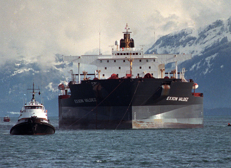 Tugboats pull the crippled tanker Exxon Valdez toward Naked Island in Prince William Sound, Alaska, in this April 5, 1989, file photo after the ship was pulled from Bligh Reef.