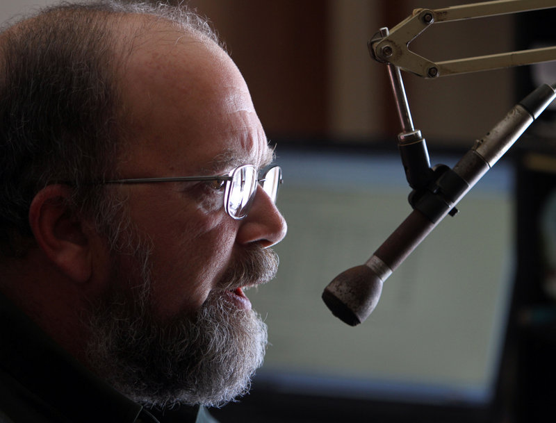 Tony Vazzano gives one of his radio weather reports in Sandwich, N.H., in between providing ski areas with individualized weather forecasts.