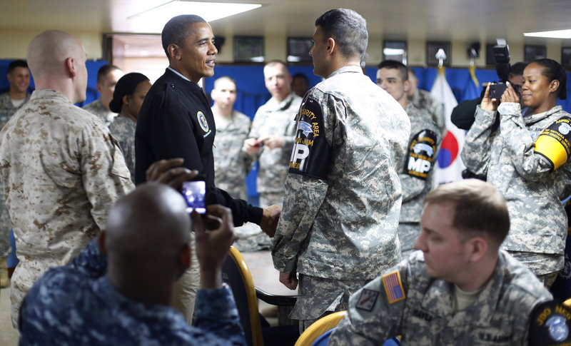 President Obama meets troops on Sunday in the dining hall at Camp Boniface just outside the Demilitarized Zone, the tense military border between North and South Korea. The president is attending a Nuclear Security Summit in Seoul.