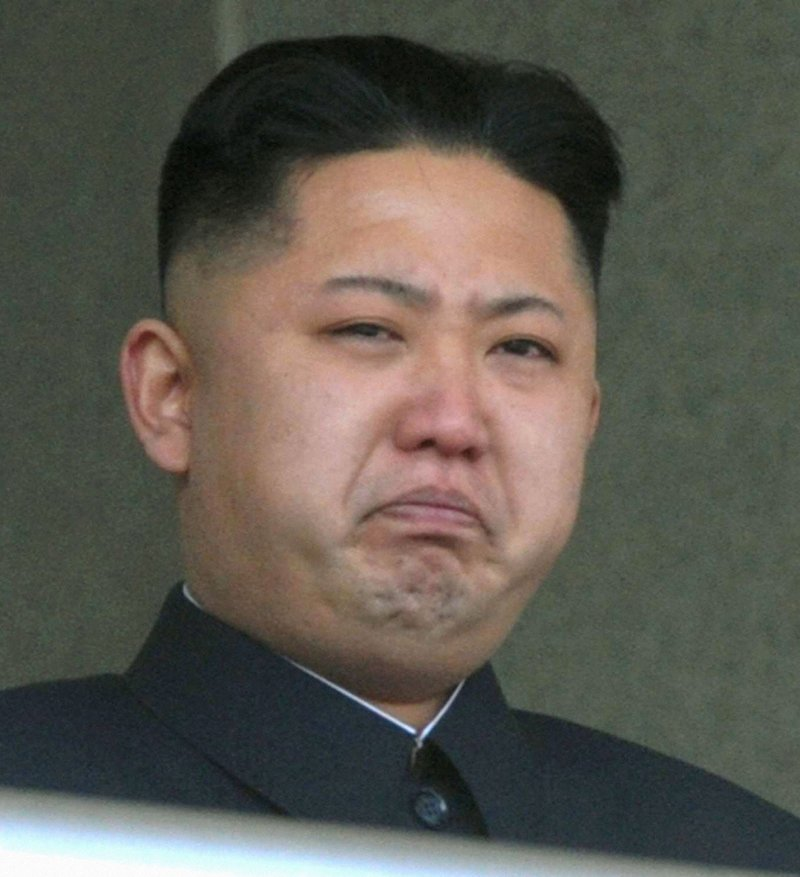 North Korea's leader Kim Jong Un weeps during a ceremony in Pyongyang on Sunday to mark 100 days since the death of his father, Kim Jong Il.