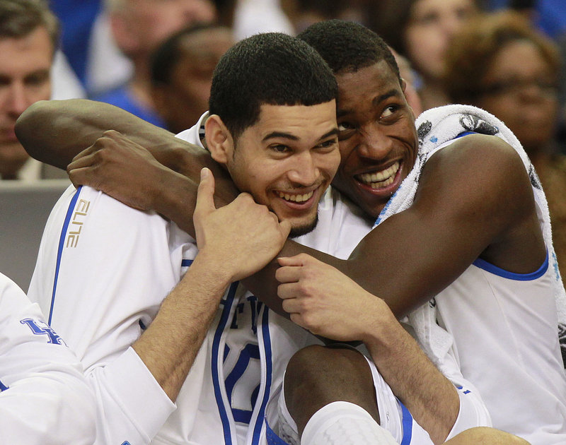 Eloy Vargas, left, and Michael Kidd-Gilchrist are simply giddy in the final seconds of Kentucky's regional final win over Baylor Sunday in Atlanta.