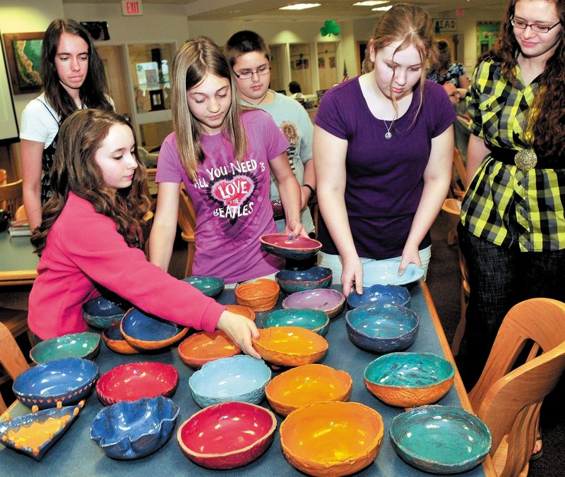 Skowhegan Area Middle School students unpack some of the 100 clay bowls they made for a fundraiser to benefit local food banks. From left are Marinel Demmons, in back, Samantha Joy, Elizabeth Jones, Andrew Todd, Mariah Bonneau and potter Yvonne Ballenbacher.