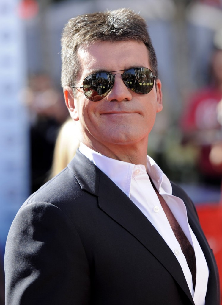 Prosecutors said Simon Cowell was watching TV in the bedroom of his London mansion Saturday night when he heard a loud bang coming from his bathroom and discovered a woman inside with a brick.