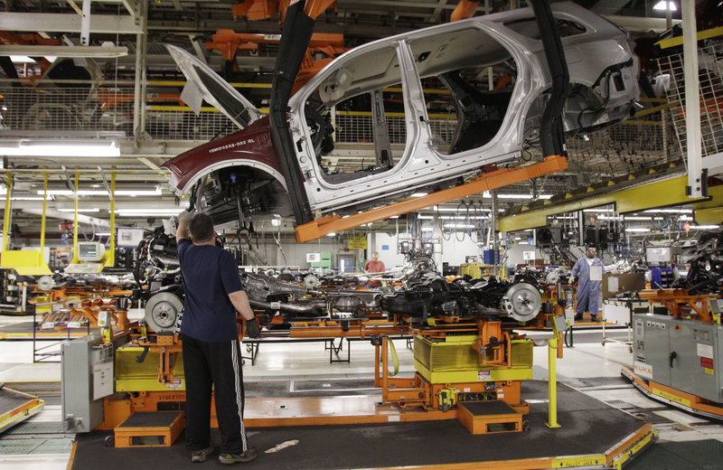 A Dodge Durango is assembled at Chrysler's Jefferson North Assembly Plant in Detroit. The unemployment rate has fallen nearly a full percentage point since last summer.