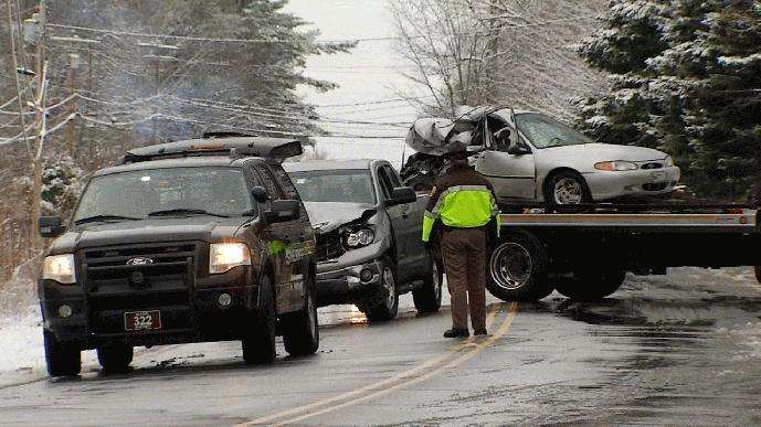 Officials remove vehicles involved in a fatal crash Wednesday morning that claimed the life of Elizabeth Polletto, 26.