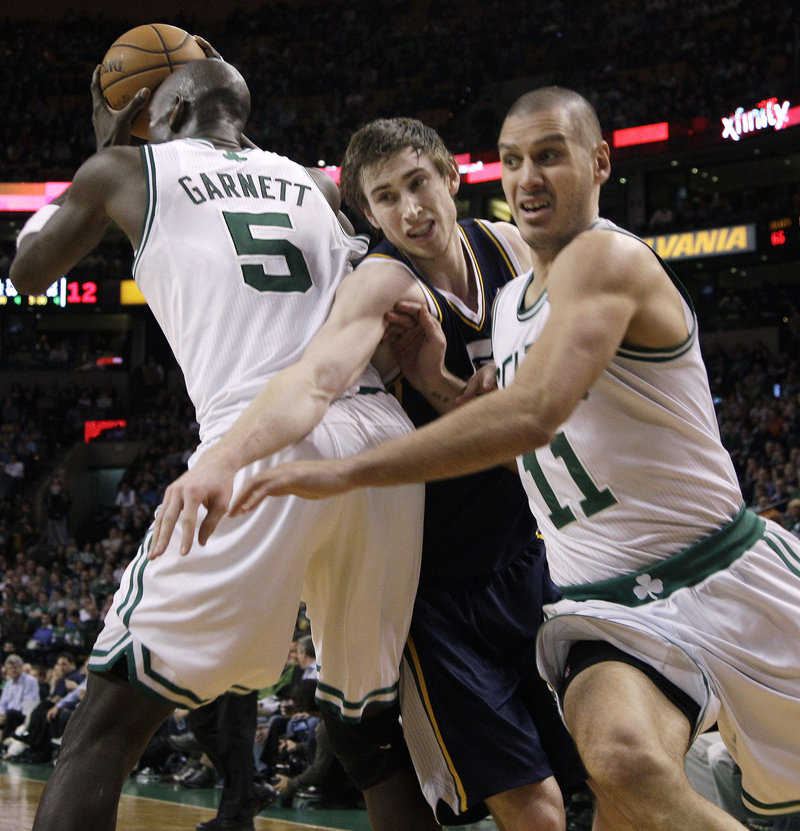 Sasha Pavlovic of the Boston Celtics heads to the basket Wednesday night as Gordon Hayward of Utah attempts to fight through a pick by Kevin Garnett, who has the ball.