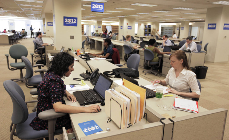 Staff members work at President Obama's 2012 re-election campaign headquarters during a media tour of the then-new facility in Chicago last year. Obama maintains a campaign operation that is larger than any of his opponents' organizations.