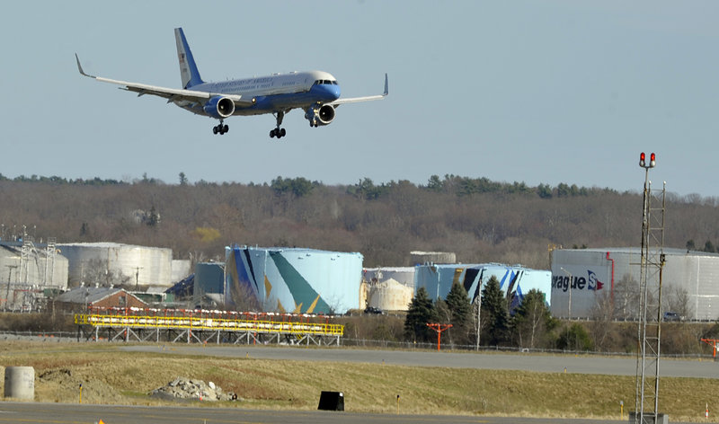 President Obama arrives on Air Force One at the Portland International Jetport on Friday afternoon.
