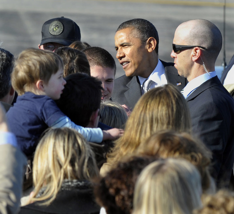 President Obama greets VIPs and their families Friday afternoon at Portland International Jetport. From there, the president headed to a fundraiser at Southern Maine Community College.