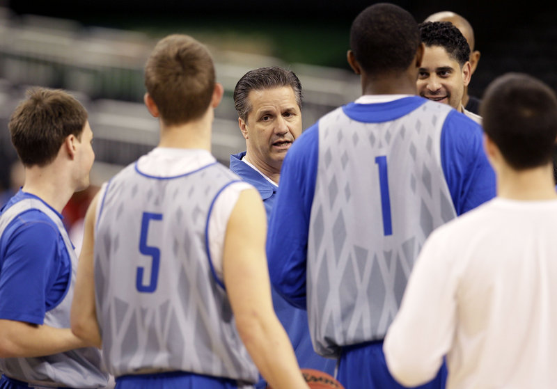 Coach John Calipari and his Kentucky Wildcats must get past Louisville today to earn a spot in the NCAA final.
