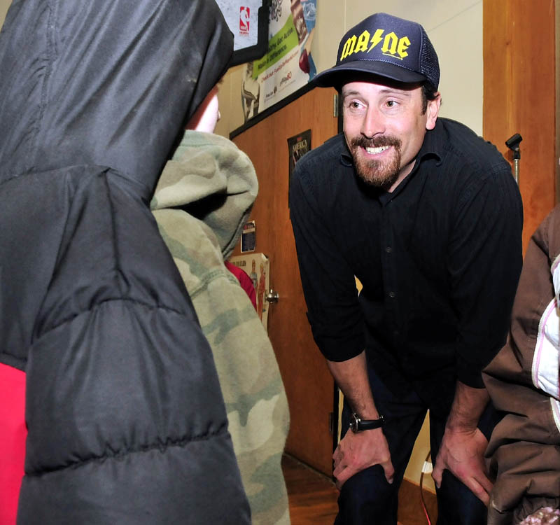 COOL: Olympic gold medalist Seth Wescott answers questions from Bloomfield Academy student Seth Campbell following a slideshow on winter activity to students at the Skowhegan school on Thursday.