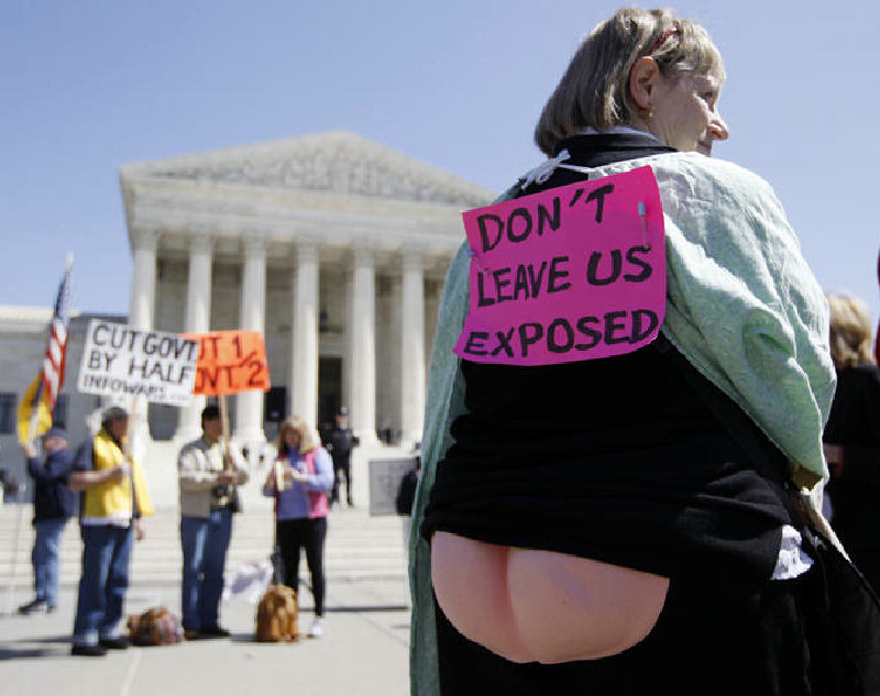 Joan Stallard, who supports health care reform, stands in front of the Supreme Court after Tuesday's session.