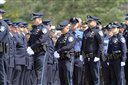 Hundreds of law enforcement officers from around New England line up to pay respect for Greenland Police chief Michael Maloney Wednesday April 18, 2012 in Hampton, N.H. during a wake service for the chief. Maloney was shot and killed when he and other officers were trying to serve a warrant at a Greenland home. Four other officers were injured.