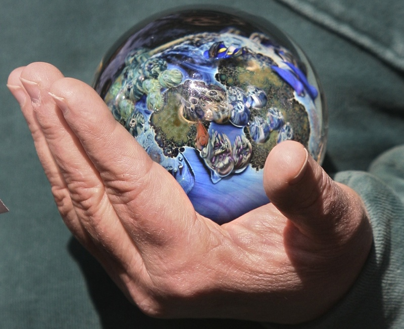 A participant in Earth Day events in Portland last year had the problems of the Earth symbolically in hand.