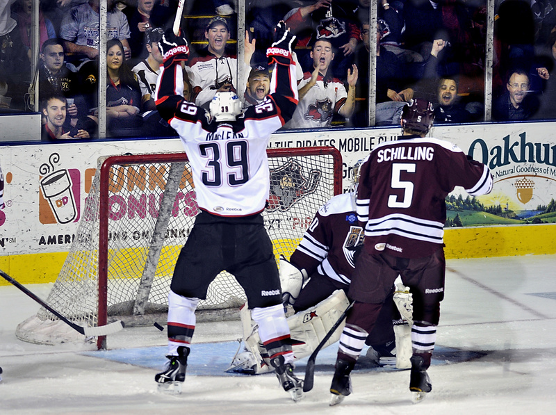 Brett MacLean of the Portland Pirates starts what became a familiar sight Friday night at the Cumberland County Civic Center – a celebration following a goal. The Pirates won a crucial game in the playoff race, skating away with a 6-4 victory against the Hershey Bears.
