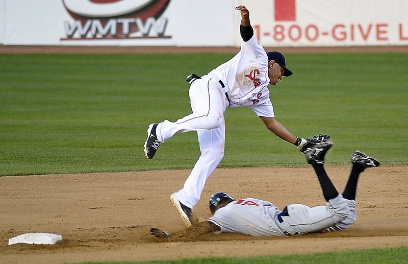 Sea Dogs second baseman Ryan Dent seems to tag Rock Cats Pedro Florimon as he slides into second but Florimon was called safe as Portland hosted New Britain at Hadlock Field in Portland tonight. The Rock Cats won 6-3.
