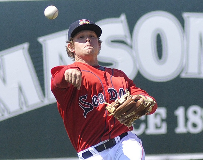 Zach Gentile, who joined the Sea Dogs about an hour before Sunday's game from Class-A Salem, throws out a runner on a grounder to second at Hadlock Field.