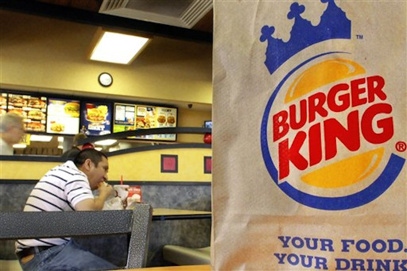 In this Aug. 24, 2010 file photo, patrons enjoy a meal at a Burger King in Springfield, Ill. The movement by U.S. food corporations toward more humane treatment of animals experienced a whopper of a shift Wednesday, April 25, 2012, when Burger King announced that all of its eggs and pork will come from cage-free chickens and pigs by 2017. The decision by the world's second-biggest fast-food restaurant raises the bar for other companies seeking to appeal to the rising consumer demand for more humanely produced fare. (AP Photo/Seth Perlman)