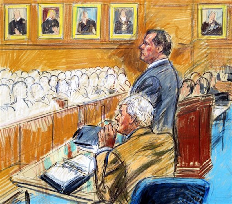This artist rendering shows former Major League Baseball pitcher Roger Clemens, standing, and his attorney Rusty Hardin, front left, facing prospective jurors inside federal court in Washington, Monday, April 16, 2012, during jury selection in the perjury trial. (AP Photo/Dana Verkouteren)