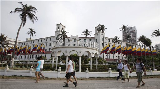 People walk past Hotel El Caribe in Cartagena, Colombia, today. The Secret Service sent home some of its agents for misconduct that occurred at the hotel before President Obama's arrival Friday for the Summit of the Americas.