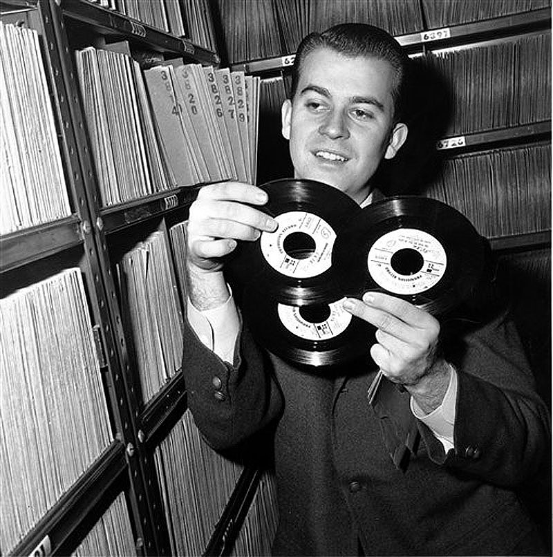 In this Feb. 3, 1959 file photo, Dick Clark selects a record in his station library in Philadelphia. Clark, the television host who helped bring rock `n' roll into the mainstream on