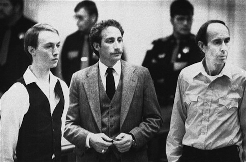 This Dec. 18, 1984 photo shows Don Nichols, right, standing with his son, Dan Nichols, left, as they pled not guilty in court in Virginia City, Mont. Standing with them is attorney, Steve Ungar. Nichols, who abducted world-class biathlete Kari Swenson in 1984 to keep as a wife for his son once wrote that blame for the